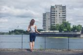 Young woman standing by marina in urban area — Stock Photo
