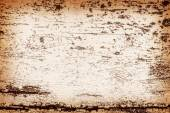 Peeling paint on weathered wood as a detailed background — Stock Photo