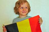 Smiling boy with a flag of Belgium — Stock Photo