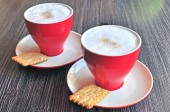 Cappucino with biscuits — Stock Photo