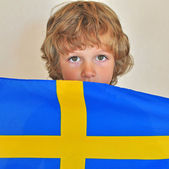 Boy with a flag of Sweden — Stock Photo