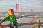 Smiling boy at the Golden bridge, Lisbon — Stock Photo