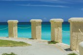 Old colonial  style stone posts on a cliff edge ocean background — Stock Photo