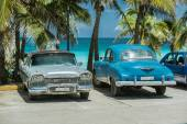 Classic,vintage cars parked against tropical background on sunny hot day — Stock Photo