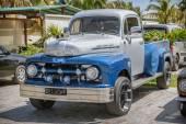 Blue, grey classic vintage pickup truck  standing in garden — Stock Photo