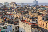 Wide  open view of old antique Cuban Havana city against ocean and sky background at sunset time — 图库照片