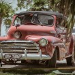 Classic retro, vintage car in Cuban tropical garden — Stock Photo #58027411