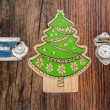 Holiday Christmas tree ornaments with various message tags isolated on old vintage classic hardwood background — Stock Photo #58540025