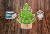 Holiday Christmas tree  ornaments with various message tags isolated on old vintage classic hardwood background — Stock Photo