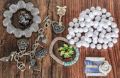 Closeup  view of various jewelry and accessories isolated on vintage retro classic hardwood background — Stock Photo