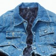 Cool fashionable blue jeans jacket lined with artificial dark blue fur — Stock Photo #64027325