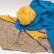 View of colorful yarn and needles cotton knitting craft on grey — Stock Photo #67545079