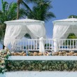 Closeup view of  two white cozy gazebos in  tropical garden on sunny gorgeous day — Stock Photo #72541701