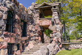 Fragment of view of  old vintage strong exterior stone  building — Stock Photo