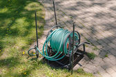 Gardening hose reel in the back yard — Stock Photo
