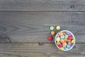 Candy multicolor on wood background — Stok fotoğraf