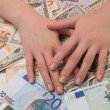 Women can enjoy money in euros and dollars lying on the table — Stock Photo #58991191