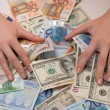 Women can enjoy money in euros and dollars lying on the table — Stock Photo #58991201