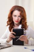 Business lady in the white shirt sitting at table with laptop and diary — Stock Photo