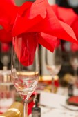 Christmas party table with red napkin in a glass — Stock Photo