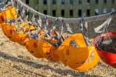Row of orange climbing helmets — Stock Photo