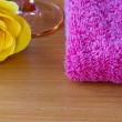Yellow rose with a wine glass and a pink towel — Stock Photo #64320963