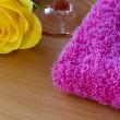 Yellow rose with a wine glass and a pink towel — Stock Photo #64321197
