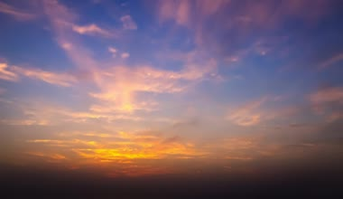 Timelapse movie of clouds at sunset above the sea — Stok video