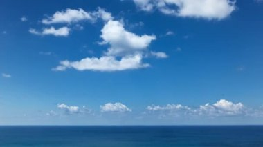Timelapse of Clouds crossing the blue sky above the sea — Stock Video