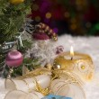 Christmas still life with gift, candle and bells — Stock Photo #57111257