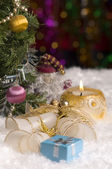 Christmas still life with gift, candle and bells — Stock Photo