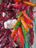 Hot peppers and garlic in market — Photo
