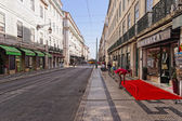 Lisbon, Portugal - May 14: Old Town Lisbon on May 14, 2014. View of the street with typical houses in Lisbon, Portugal, Europe. — Stock Photo
