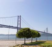 Lisbon, Portugal - May 15: 25th of April bridge in Lisbon on May 15, 2014. 25th of April bridge was originally named for Portugal's right-wing dictator, Antonio de Oliveira Salazar. Portugal, Europe. — Stock Photo