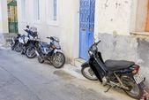 Poros, Greece - September 27, 2014: Several modern scooters park — Stockfoto