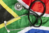 Medical stethoscope on South African flag — Stock Photo