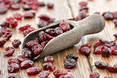 Cranberries on wooden spoon — Stock Photo