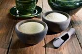 Couscous in wooden bowls — Stock Photo