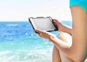 Woman with tablet pc at the beach — Stock Photo