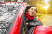 Girl driving a red car. — Stok fotoğraf