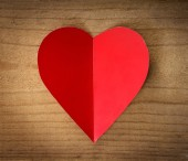 Red heart on a wooden background. — 图库照片