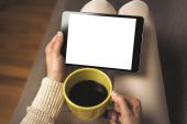 Woman on the sofa with tablet pc — Foto de Stock