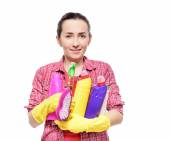 Lady holding basin with cleaning supplies. — Stock Photo