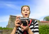 Tourist girl using camera. — Stock Photo