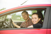 Couple in a red car — Stock Photo