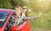 Girls in a red car. — Stock Photo