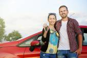 Couple near the red car. — Stock Photo