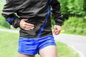 Runner side cramps after running — Stock Photo