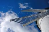 Lighthouse - windmill against the sky - Swinoujscie — Stock Photo
