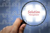 Solution management word. Magnifier and puzzles. — Stock Photo